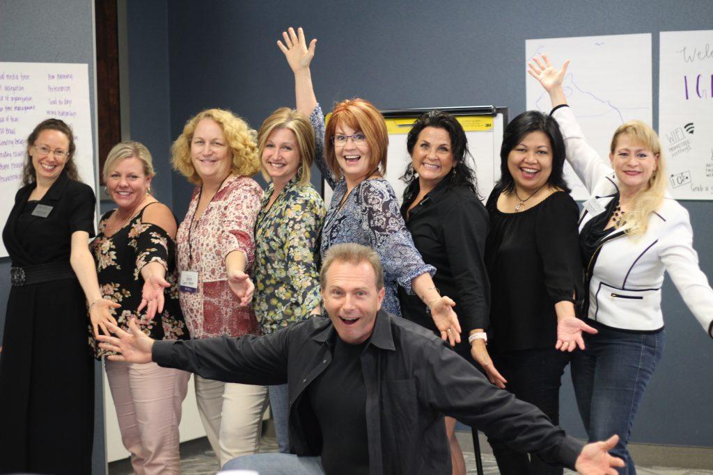 Photo of happy clients at seminar